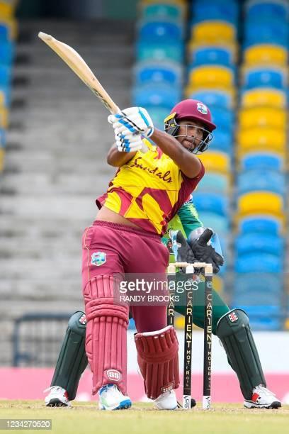 Nicholas Pooran of West Indies hits 6 during the 1st T20I between West Indies and Pakistan at Kensington Oval, Bridgetown, Barbados, on July 28, 2021.