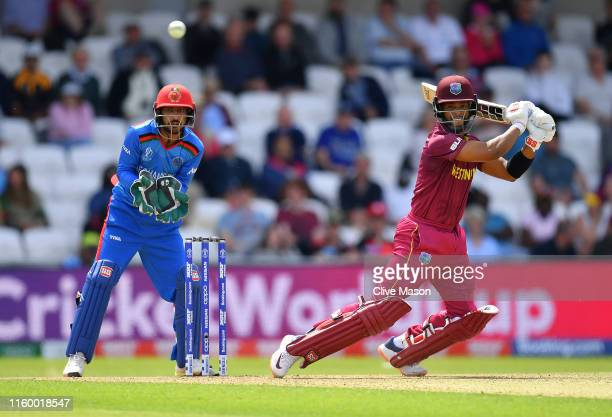 Nicholas Pooran of West Indies in action batting as Ikram Ali Khil of Afghanistan looks on during the Group Stage match of the ICC Cricket World Cup...