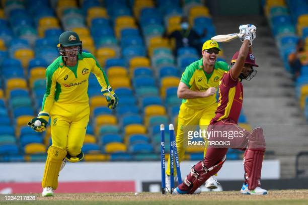 Nicholas Pooran of West Indies is bowled by Ashton Turner as Alex Carey and Daniel Christian of Australia celebrate during the 3rd and final ODI...