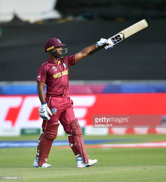 Nicholas Pooran of West Indies raises his bat after scoring 100 runs during the Group Stage match of the ICC Cricket World Cup 2019 between Sri Lanka...
