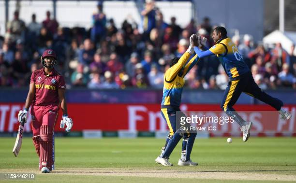 Nicholas Pooran of West Indies walks off after being dismissed by Angelo Matthews of Sri Lanka during the Group Stage match of the ICC Cricket World...