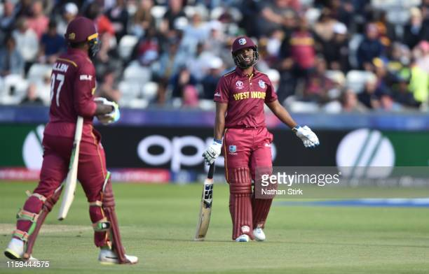Nicholas Pooran questions Fabian Allen of West Indies after Fabian Allen is run out by Kasun Rajithan of Sri Lanka during the Group Stage match of...