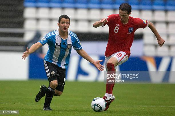 Nicholas Powell of England struggles for the ball with Alexis Zarate of Argentina during the FIFA U17 World Cup Mexico 2011 Round of 16 match between...