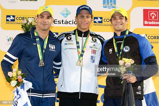 Nicholas Santos, Cesar Cielo and Marcelo Chiereghini pose during the awards ceremony after the 50m Butterfly Final on day five of the Maria Lenk...