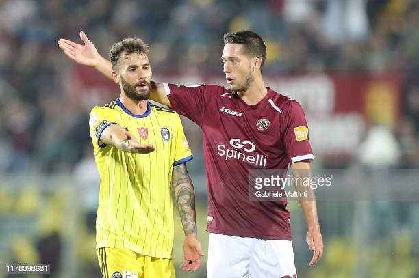 Nicholas Siega of Pisa Sc and Lorenzo Gonnelli of AS Livorno Calcio gesture during the Serie B match between AS Livorno and Pisa SC at Stadio Armando...