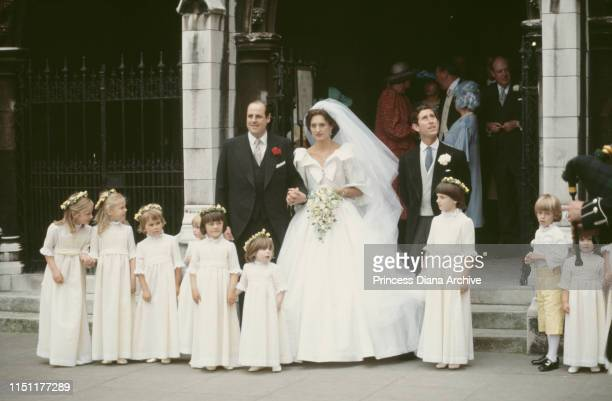 Nicholas Soames and Catherine Weatherall pose with their bridesmaids and Prince Charles the best man during their wedding at St Margaret's Church in...