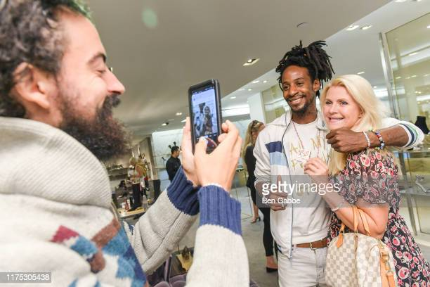 Nicholas Sosin Americk Lewis and Nina Junotattend a Brunch In Support Of The World Childhood Foundation USA hosted by Barneys New York on September...