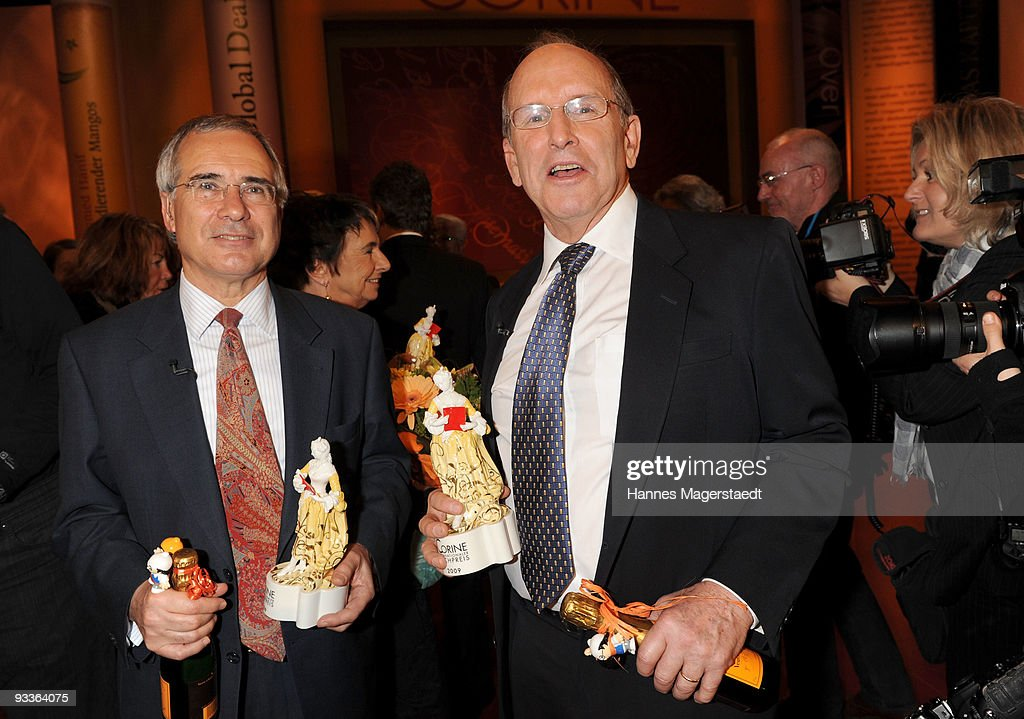 Nicholas Stern and Alex S. MacLean hold their awards during the annual Corine awards at the Prinzregenten Theatre on November 24, 2009 in Munich, Germany. The Corine Awards are considered as one of the most prestigious German prizes for literature.