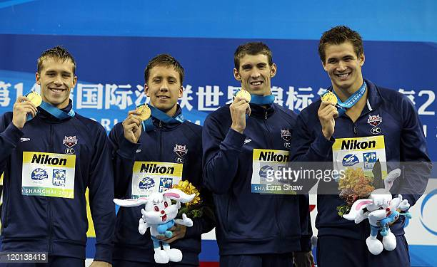 Nicholas Thoman Mark Gangloff Michael Phelps and Nathan Adrian of the United States pose with their gold medals after winning the Men's 4x100m Medley...