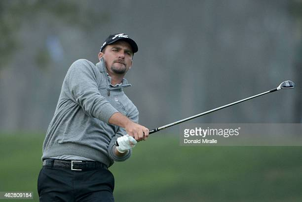Nicholas Thompson hits off the 18th fairway during the First Round of the Farmers Insurance Open at Torrey Pines Golf Course on February 5 2015 in La...