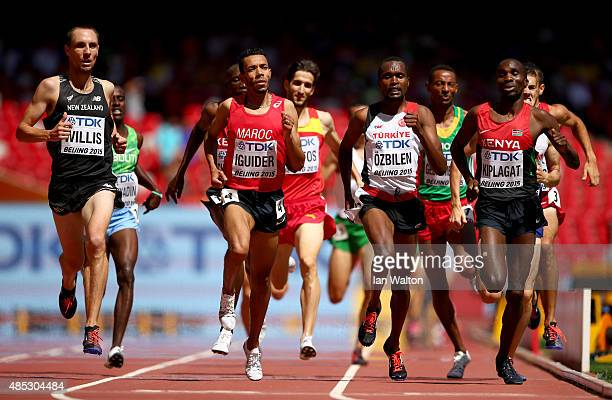 Nicholas Willis of New Zealand, Abdalaati Iguider of Morocco, Ilham Tanui Ozbilen of Turkey and Silas Kiplagat of Kenya compete in the Men's 1500...