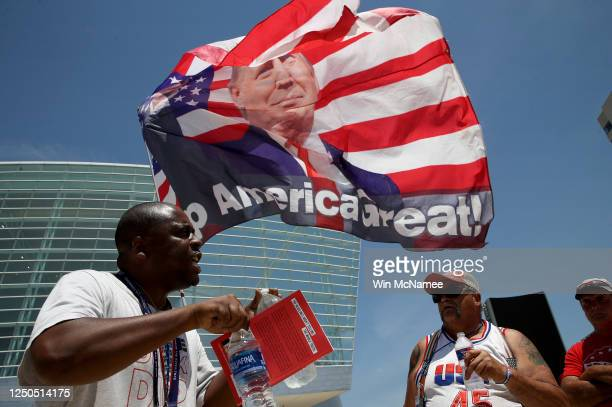 Nicholas Winford debates Trump supporter Randall Thom on the racial policies of US President Donald Trump outside the BOK Center June 18 2020 in...