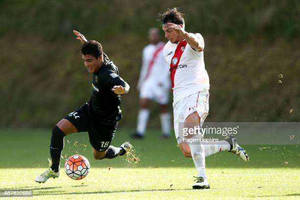 Nicholas Zambrano of Team Wellington and Ryan Cain of Waitakere United compete for the ball during the ASB Premiership Semi Final match between Team...