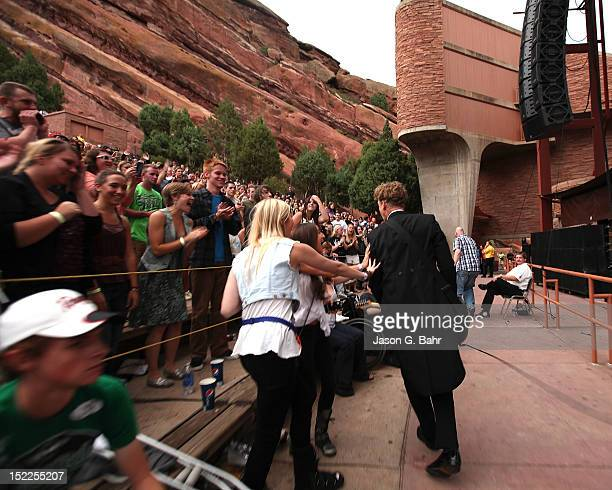 Nicholaus Arson of the Hives takes to the crowd during a performance at Red Rocks Amphitheatre on September 16 2012 in Morrison Colorado