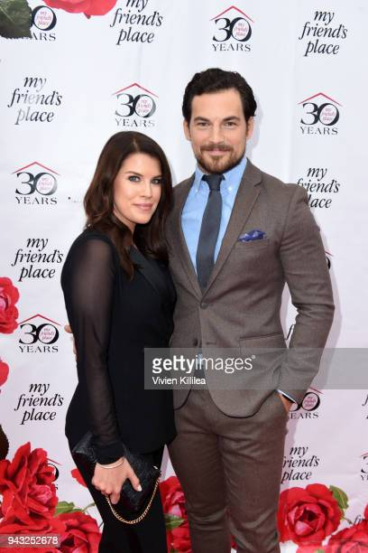Nichole Gustafson and Giacomo Gianniotti attend the My Friend's Place 30th Anniversary Gala at Hollywood Palladium on April 7 2018 in Los Angeles...
