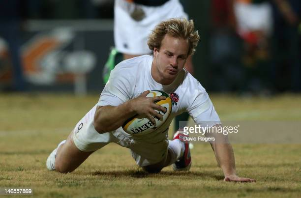 Nick Abendanon dives to score his second try during the match between South Africa Barbarians North and England at Olen Park on June 19 2012 in...