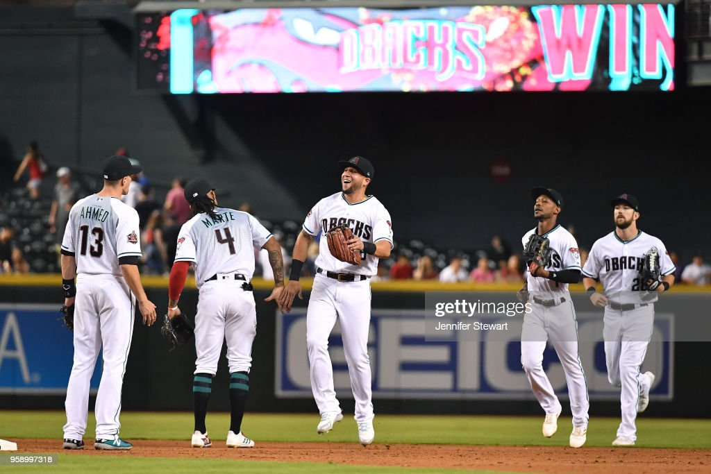 Nick Ahmed #13, Ketel Marte #4, David Peralta #6, Jarrod Dyson #1 and Steven Souza Jr. #28 of the Arizona Diamondbacks celebrate after closing out the MLB game against the Milwaukee Brewers at Chase Field on May 15, 2018 in Phoenix, Arizona.