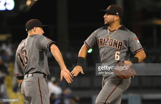 Nick Ahmed of the Arizona Diamondbacks and David Peralta celebrate a 31 win over the Los Angeles Dodgers at Dodger Stadium on August 30 2018 in Los...