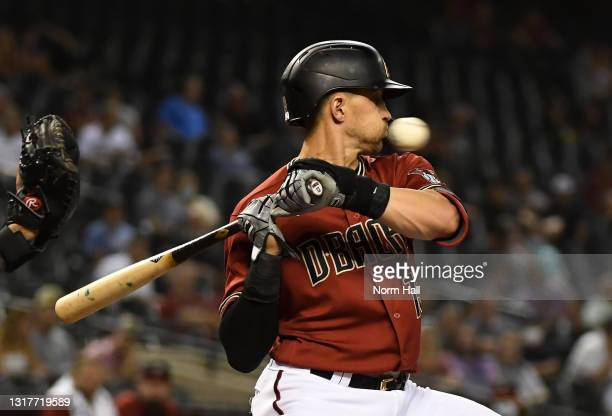 Nick Ahmed of the Arizona Diamondbacks avoids an inside pitch against the Miami Marlins during the fifth inning at Chase Field on May 12, 2021 in...