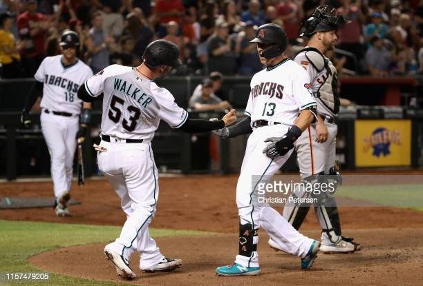 Nick Ahmed of the Arizona Diamondbacks celebrates with Christian Walker after hitting a tworun home run against the San Francisco Giants during the...