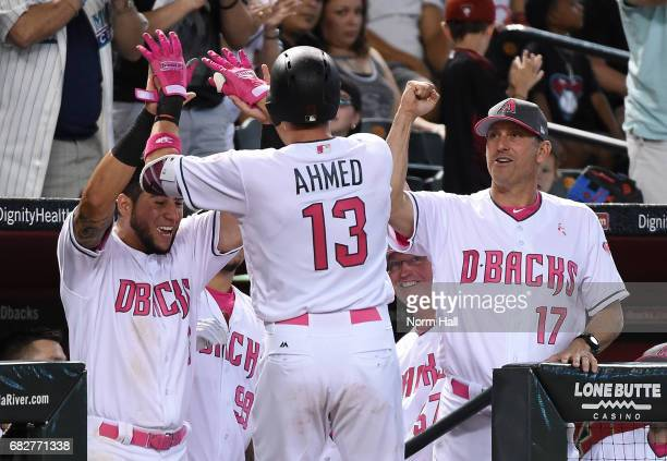 Nick Ahmed of the Arizona Diamondbacks celebrates with manager Torey Lovullo and David Peralta after hitting a solo home run off of Trevor Williams...