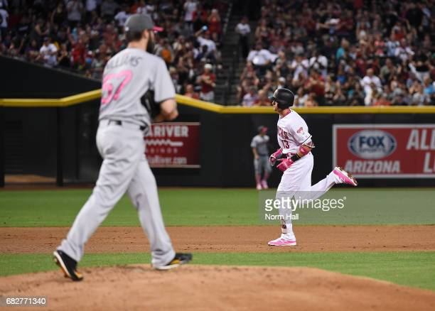 Nick Ahmed of the Arizona Diamondbacks rounds the bases after hitting a solo home run off of Trevor Williams of the Pittsburgh Pirates during the...