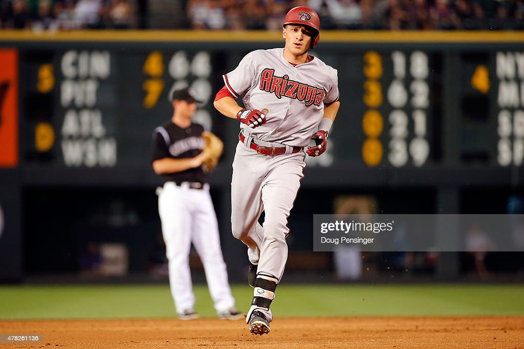 Nick Ahmed #13 of the Arizona Diamondbacks rounds the bases on his solo home run off of Kyle Kendrick #38 of the Colorado Rockies to take a 3-0 lead in the second inning at Coors Field on June 23, 2015 in Denver, Colorado. The Rockies defeated the Diamondbacks 10-5.