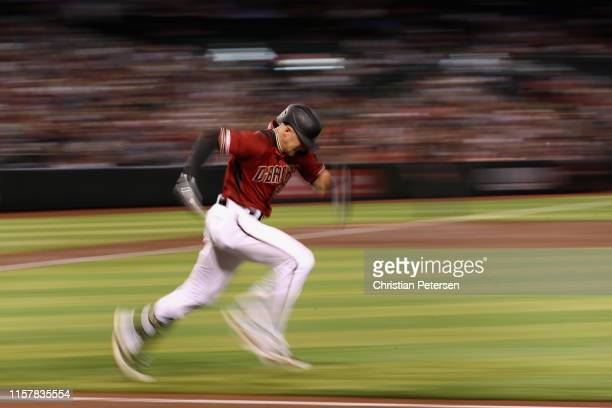 Nick Ahmed of the Arizona Diamondbacks runs to first base on a ground ball out during the third inning of the MLB game against the San Francisco...
