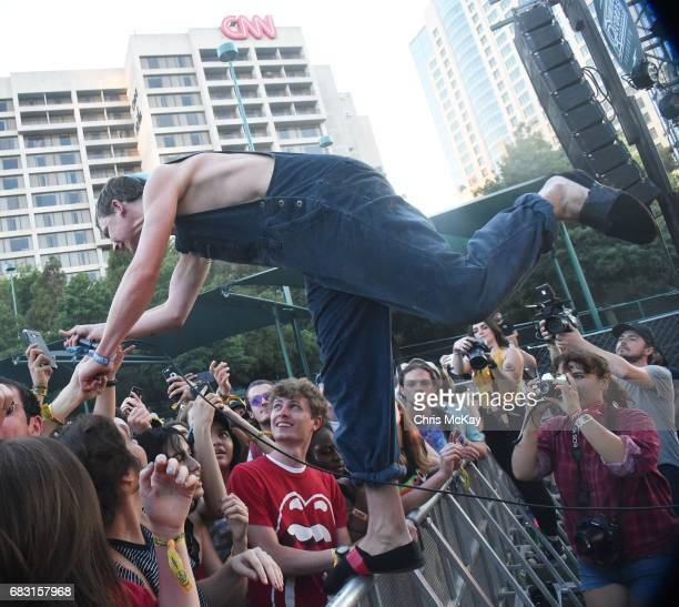 Nick Allbrook of Pond goes into the audience to perform at Shaky Knees Music Festival at Centennial Olympic Park on May 14, 2017 in Atlanta, Georgia.