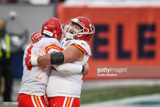 Nick Allegretti yells as he celebrates with Chad Henne after a fourth quarter Henne touchdown against the Denver Broncos at Empower Field at Mile...