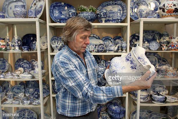 Nick Alloway examines a piece of British blue and white transferware on the Sue Norman stand at the Olympia International Fine Art and Antiques Fair...