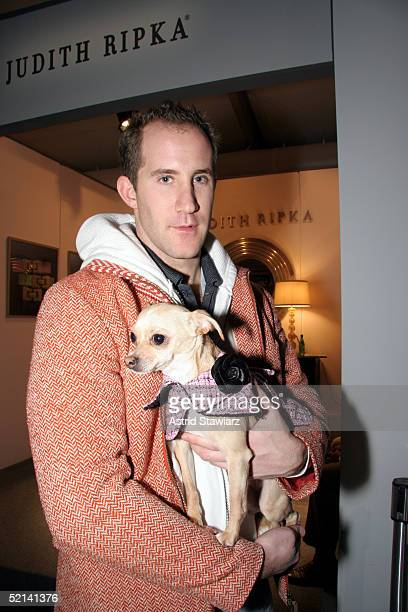 Nick Anburgie and chihuahua Lucy Anne attend Olympus Fashion Week Fall 2005 at Bryant Park February 05, 2005 in New York City.