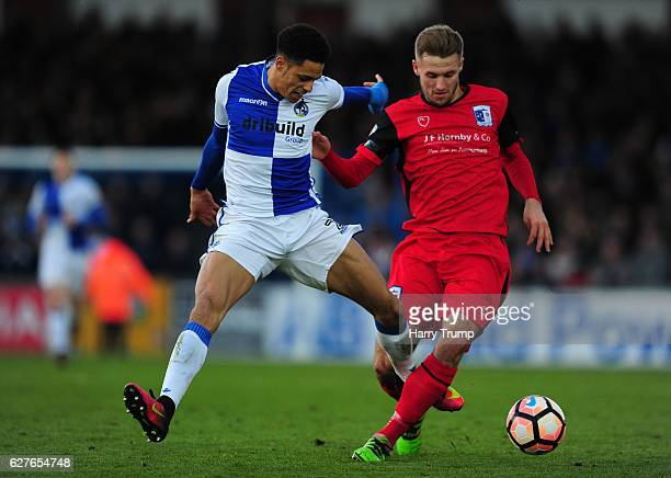 Nick Anderson of Barrow FC is tackled by Daniel Leadbitter of Bristol Rovers during the Emirates FA Cup Second Round match between Bristol Rovers and...