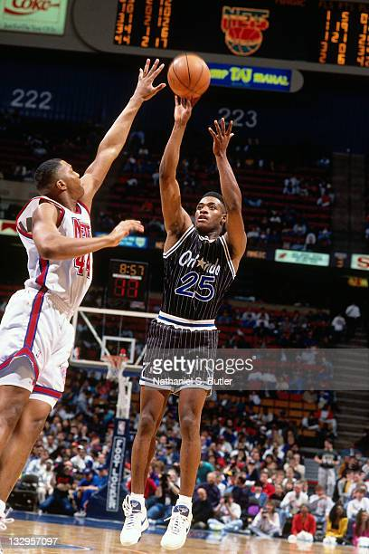 Nick Anderson of the Orlando Magic shoots against Derrick Coleman of the New Jersey Nets circa 1991 at the Brendan Byrne Arena in East Rutherford New...