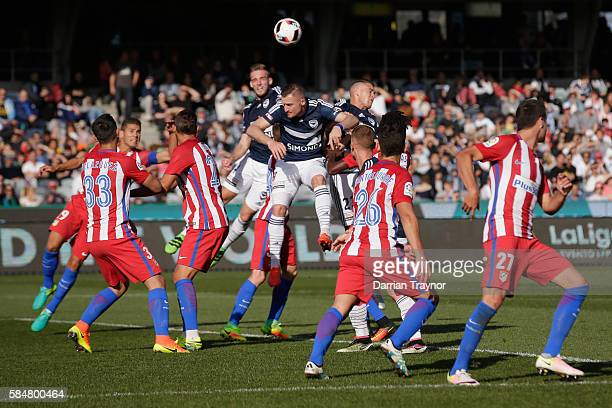 Nick Ansell of the Victory leaps to head the ball for a goal during the match between Melbourne Victory and Atletico de Madrid at Simonds Stadium on...