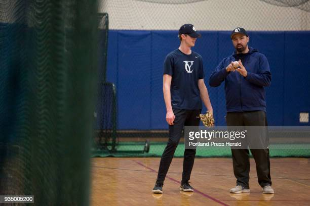 Nick Arno the JV baseball coach at right talks with junior Aaron Belesca during the first day of baseball practice at Yarmouth High School