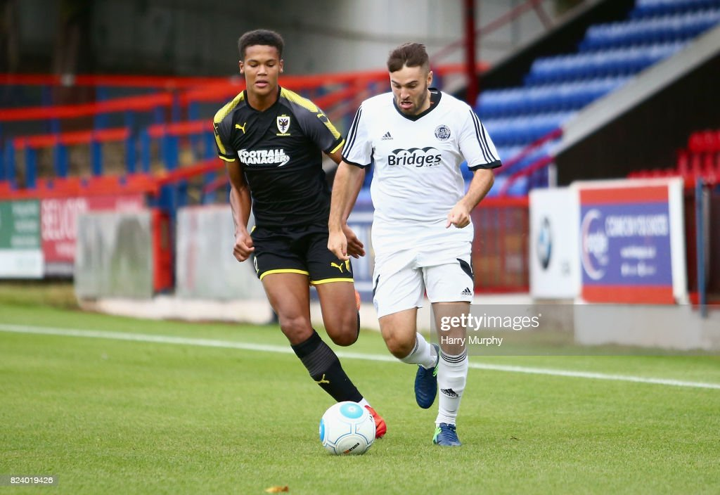 Nick Arnold of Aldershot Town and Toby Sibbick of AFC Wimbledon battle for possession during the Pre-Season Friendly match between Aldershot Town and AFC Wimbledon on July 28, 2017 in Aldershot, England.