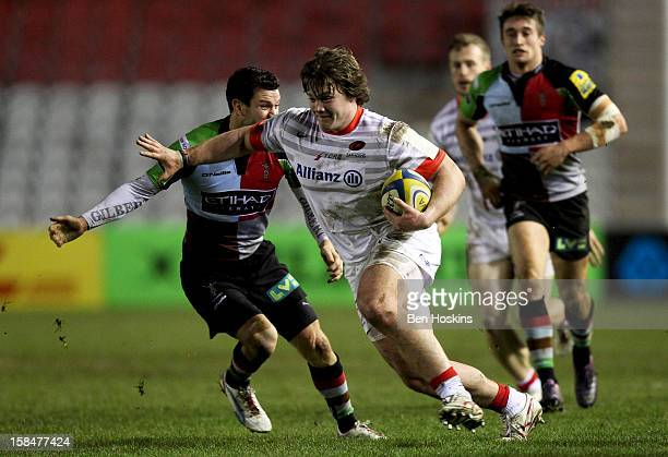 Nick Auterac of Saracens hands off the tackle of Karl Dickson of Harlequins during the Aviva 'A' league match between Harlequins and Saracens Storm...