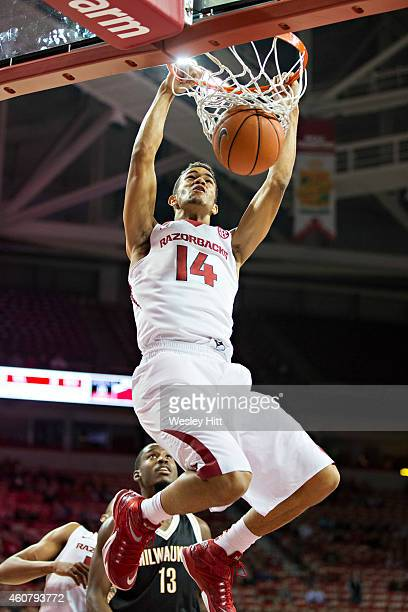 Nick Babb of the Arkansas Razorbacks dunks the ball against the Milwaukee Panthers at Bud Walton Arena on December 22, 2014 in Fayetteville,...