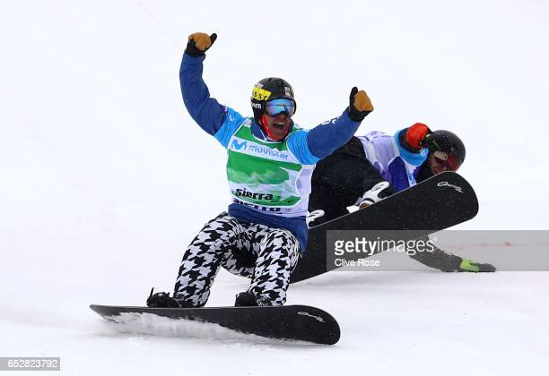 Nick Baumgartner of the United States celebrates winning the gold medal in the Men's Team Snowboard Cross Final on day six of the FIS Freestyle Ski...