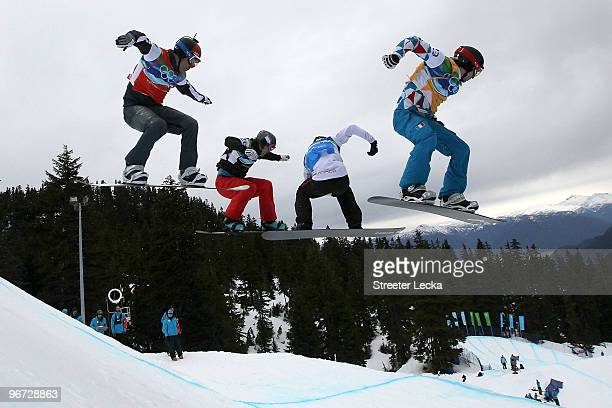 Nick Baumgartner of United States David Speiser of Germany Robert Fagan of Canada and PaulHenri De Le Rue of France compete in heat seven of the 1/8...