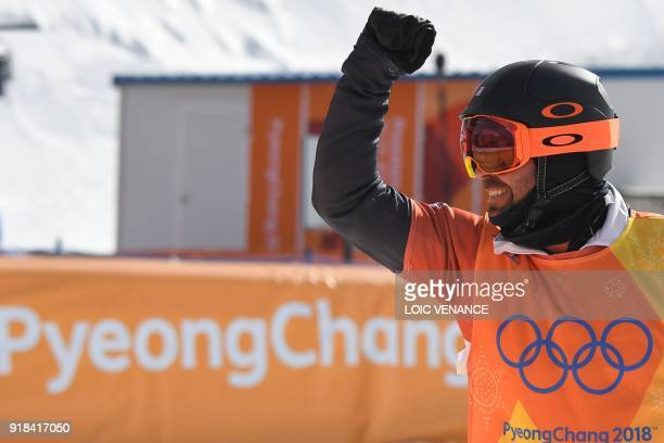 Nick Baumgartner reacts after a men's snowboard cross semi-final at the Phoenix Park during the Pyeongchang 2018 Winter Olympic Games on February 15,...