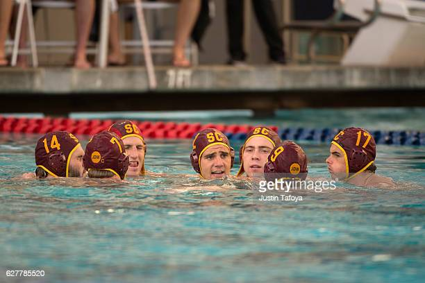 Nick Bell of the University of Southern California talks with his teammates before the Division I Men's Water Polo Championship held at the Spieker...