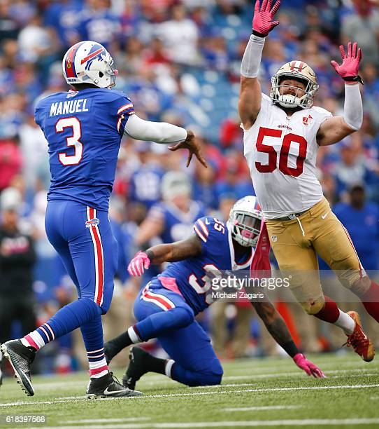 Nick Bellore of the San Francisco 49ers pressures Tyrod Taylor of the Buffalo Bills during the game at New Era Field on October 16, 2016 in Orchard...