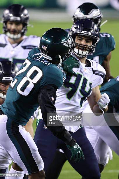 Nick Bellore of the Seattle Seahawks and Will Parks of the Philadelphia Eagles tangle during the first quarter at Lincoln Financial Field on November...