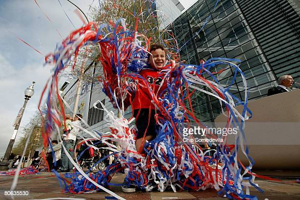 Nick Bennett of New Orleans, Louisana, wraps himself in confetti streamers during the grand opening of The Newseum April 11, 2008 in Washington, DC....