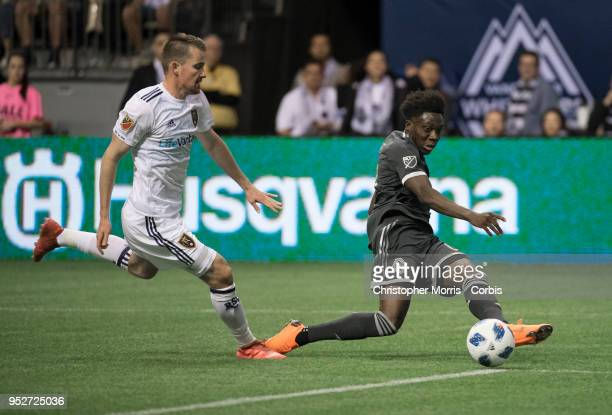 Nick Besler of Real Salt Lake chases Alphonso Davies of Vancouver Whitecaps as he assists on the Whitecaps second goal at BC Place on April 27 2018...