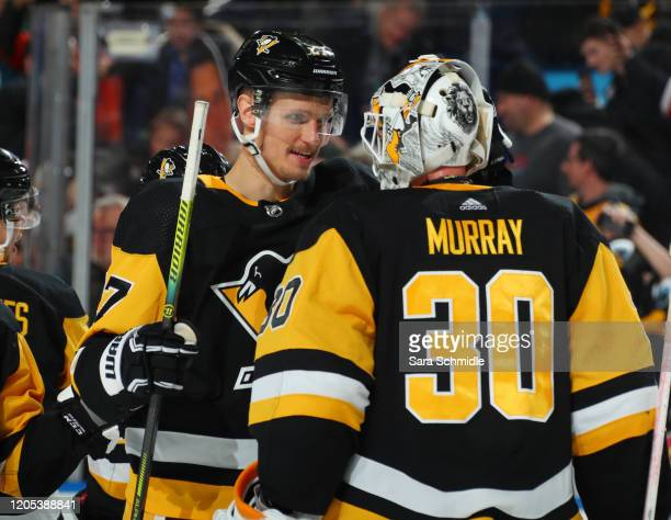 Nick Bjugstad and Matt Murray of the Pittsburgh Penguins celebrate a 4-2 victory over the Buffalo Sabres after an NHL game on March 5, 2020 at...