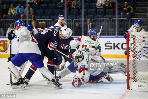 Nick Bjugstad is challenged by Andreas Bernard goalkeeper of Italy during the 2017 IIHF Ice Hockey World Championship game between USA and Italy at...