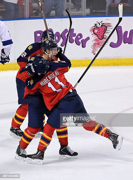 Nick Bjugstad is congratulated by Jonathan Huberdeau of the Florida Panthers after scoring the game winning goal during a game against the Tampa Bay...